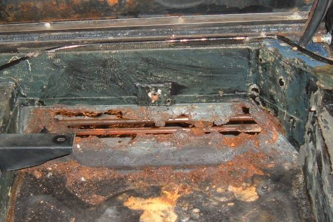 how to fix a rust hole in a car frame